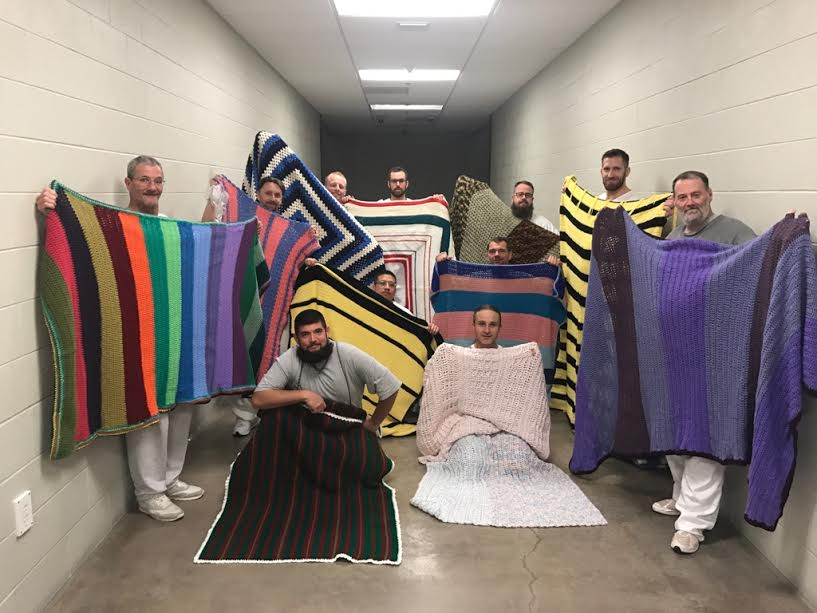 "The Kane County Jail ""inmate elves"" display blankets they crocheted for charity, Kanab, Utah, date not specified 