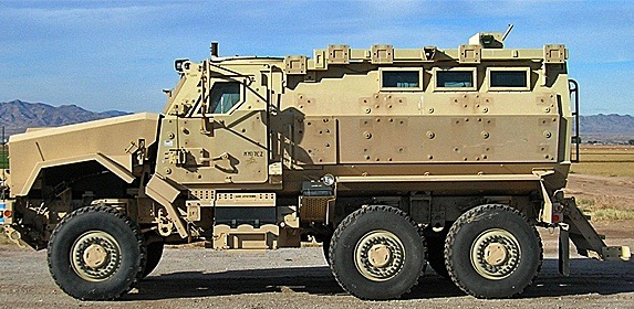This 2014 file photo shows a mine-resistant, armored- patrol vehicle, or MRAP, acquired by the Mohave County Sheriff's Office in Arizona through a Military 1033 program. In a statement issued, Mohave County Sheriff Jim McCabe said the vehicle received was much larger than the one ordered two years prior. He returned the MRAP when it generated controversy. Mohave County, Arizona, circa December 2014 | Photo courtesy of the Mohave County Sheriff's Office, St. George News | Read more here and here.