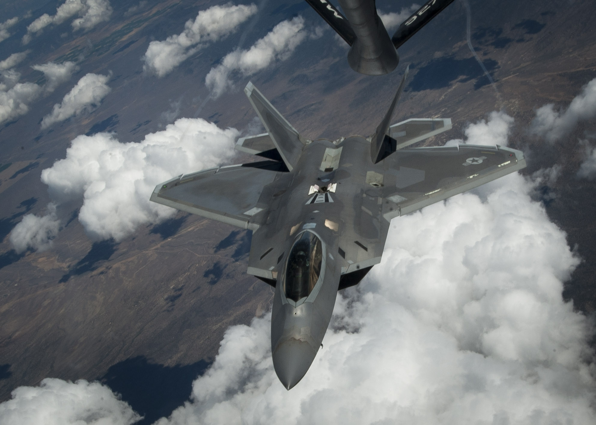 An F-22 Raptor banks off after receiving fuel from a KC-135 Stratotanker over the Nevada Test and Training Range in a training sortie during a Red Flag exercise in which units from the U.S. Air Force, Marine Corps and Navy work together to succeed in air, space and cyberspace, Nevada, July 21, 2016 | Photo courtesy of and by U.S. Air Force Senior Airman Jake Carter