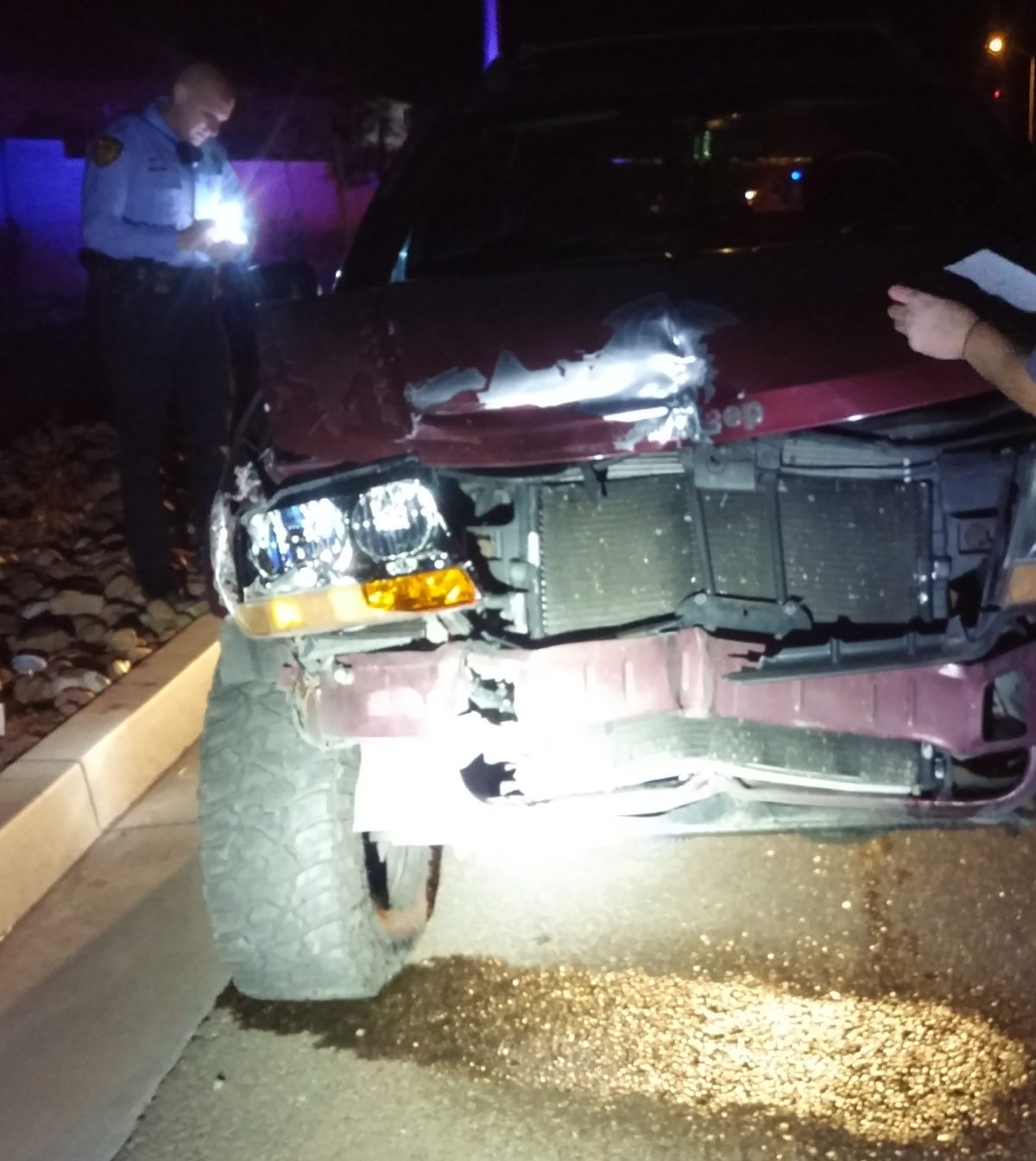 Maroon 2001 Jeep Cherokee was involved in a single vehicle crash involving two electrical boxes that were replaced when more than 350 customers lost power early Thursday morning in St. George, Utah, Dec. 8, 2016 | Photo courtesy of Lona Trombley, St. George News