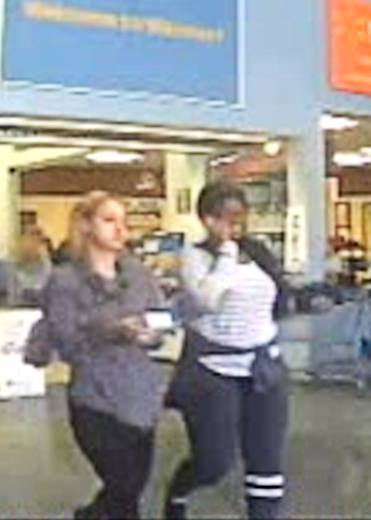 St. George Police released this photo Wednesday showing two suspects wanted for questioning in a theft and fraud investigation that allegedly occurred in St. George, Utah, Dec. 17, 2016   Photo courtesy of the St. George Police Department, St. George News