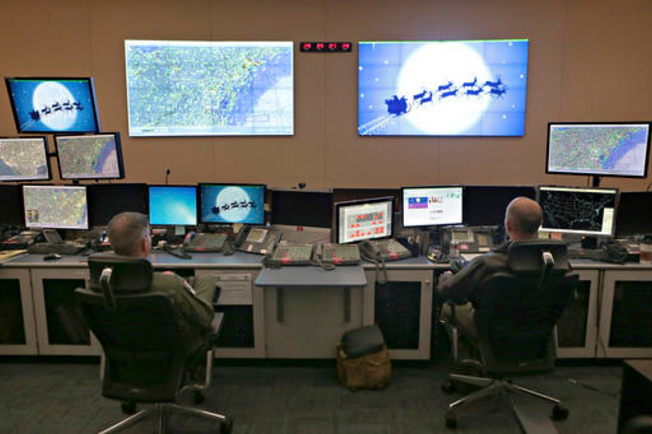 Members of the 601st Air Operations Center will watch Santa fly around the world on Christmas Eve with their NORAD Santa tracker in Panama City, Florida, Dec. 23, 2016   Heather Howard/News Herald via AP. St. George News