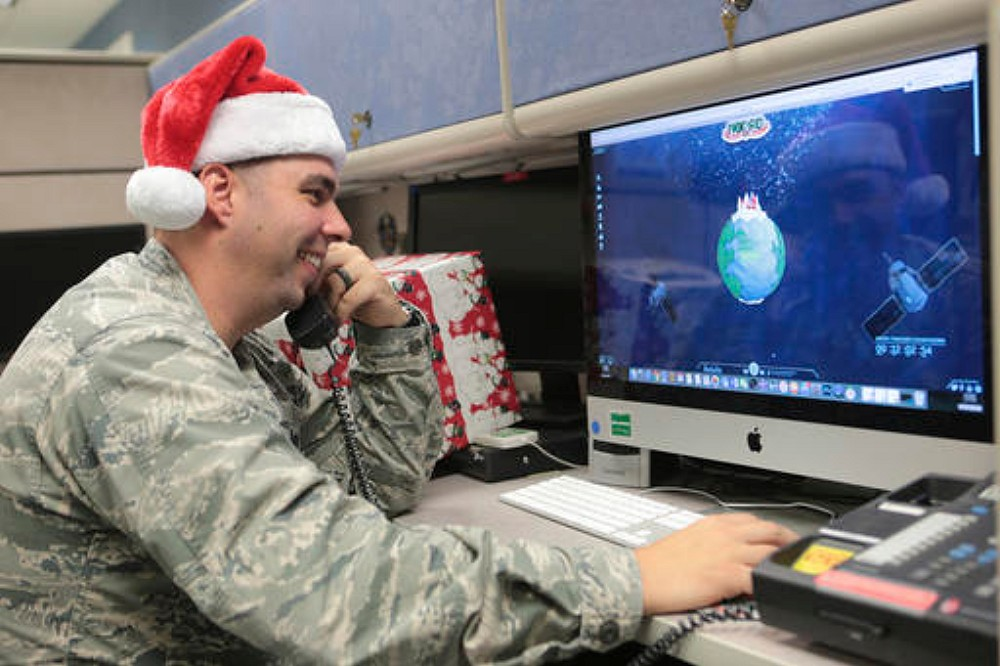 Maj. Jared Scott, makes sure NORAD's Santa tracker is working correctly at Tyndall Air Force Base on Friday, Dec. 23, 2016 in Panama City, Florida, Dec. 23, 2016 | Heather Howard/News Herald via AP, St. George News