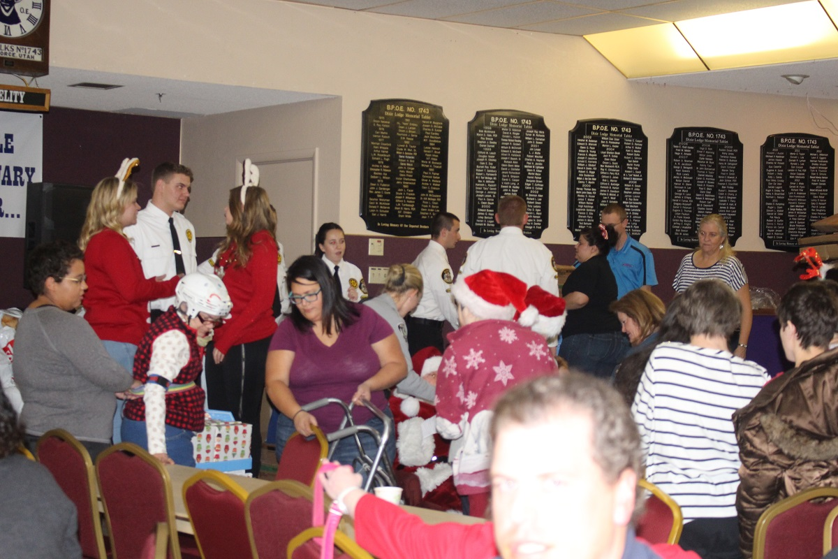 Washington County Explorer cadets handed out gift sets and stuffed animals to those waiting to see Santa at the Christmas Dinner hosted by the Arc of Washington County Tuesday at the Dixie Elks Lodge in St. George, Utah, Dec. 6, 2016 | Photo by Cody Blowers, St. George News
