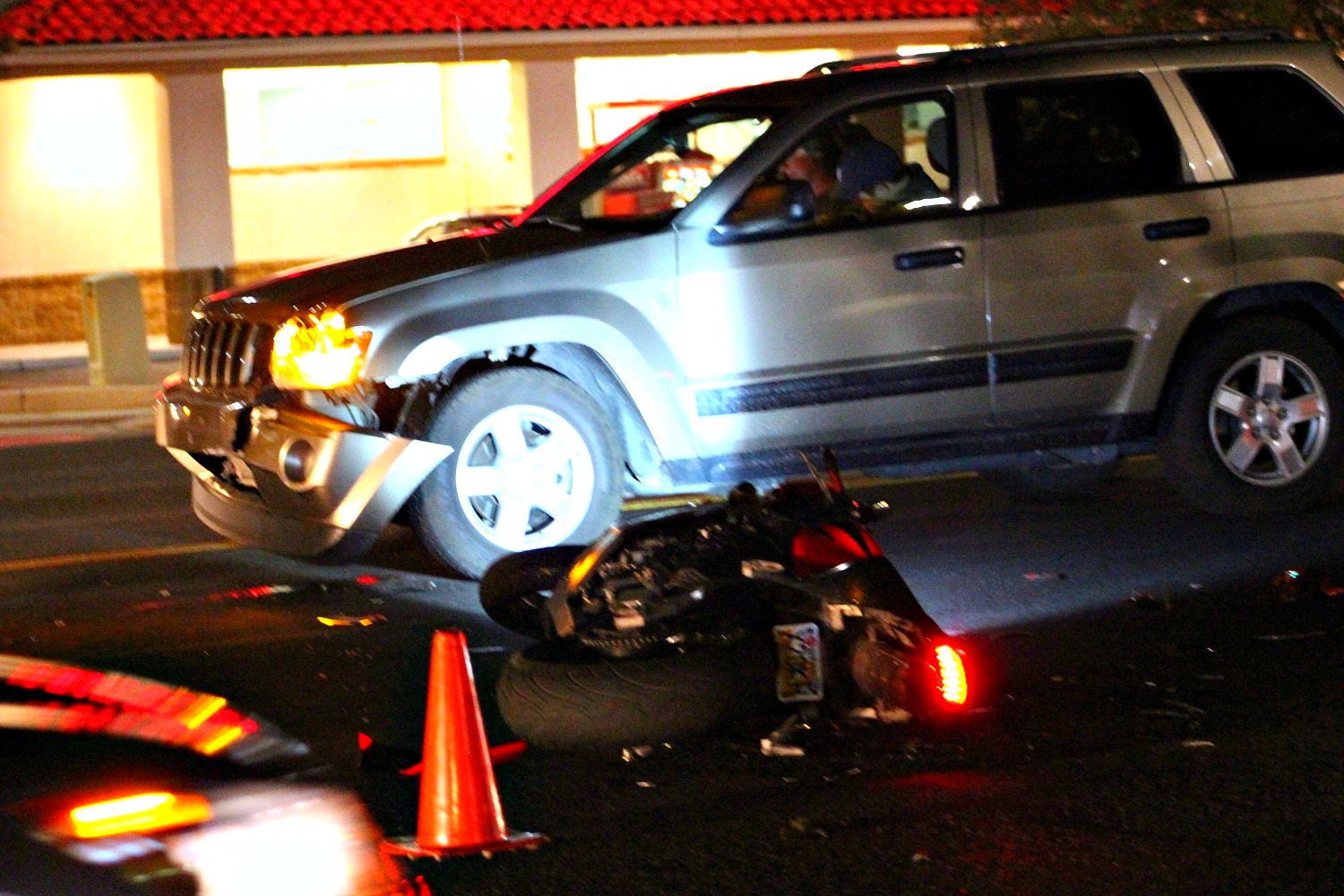 A crash Friday evening in the median of W. Sunset Boulevard left a gold Jeep Cherokee with front end damage after a Honda motorcycle crashed into the front bumper in St. George, Utah, Dec. 2, 2016 | Photo by Cody Blowers, St. George News