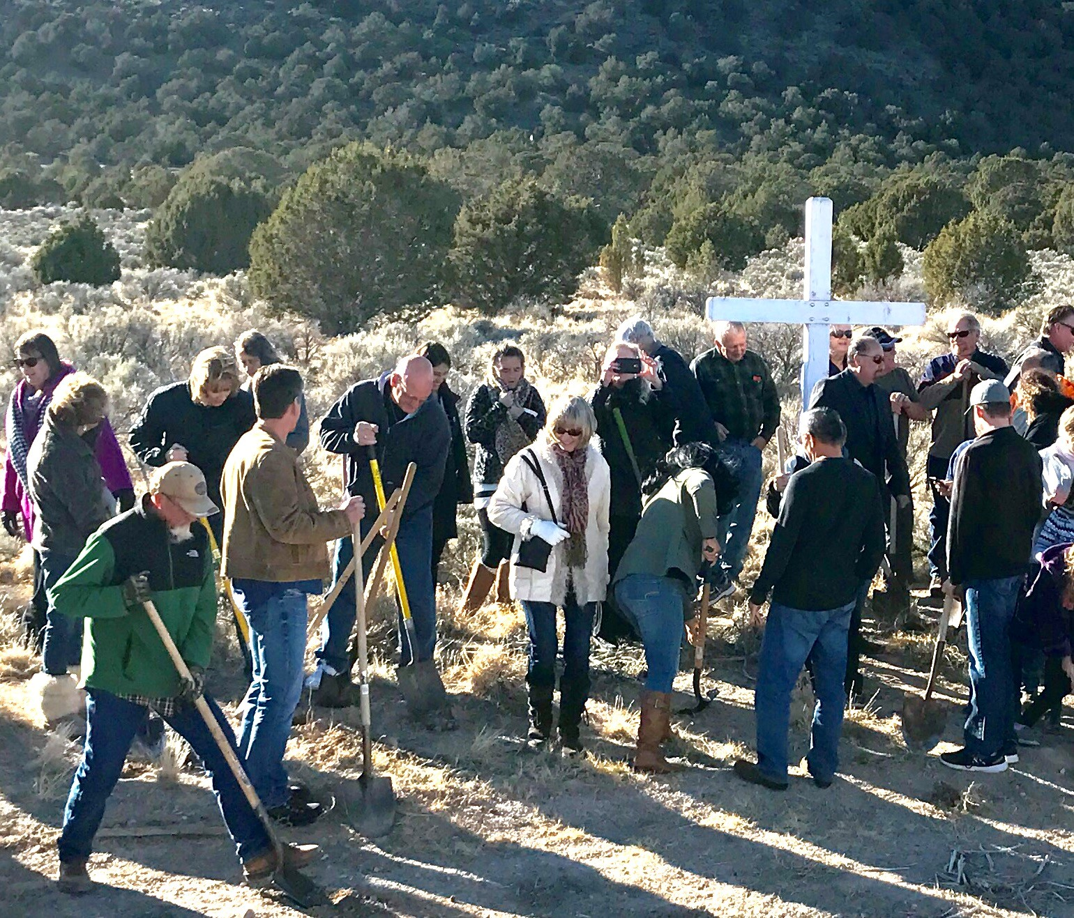 Church members break ground Sunday during the property dedication and groundbreaking at the site for the new Sonrise Fellowship Church. Iron County, Utah, Dec. 4, 2016 | Photo by Tracie Sullivan, St. George News / Cedar City News