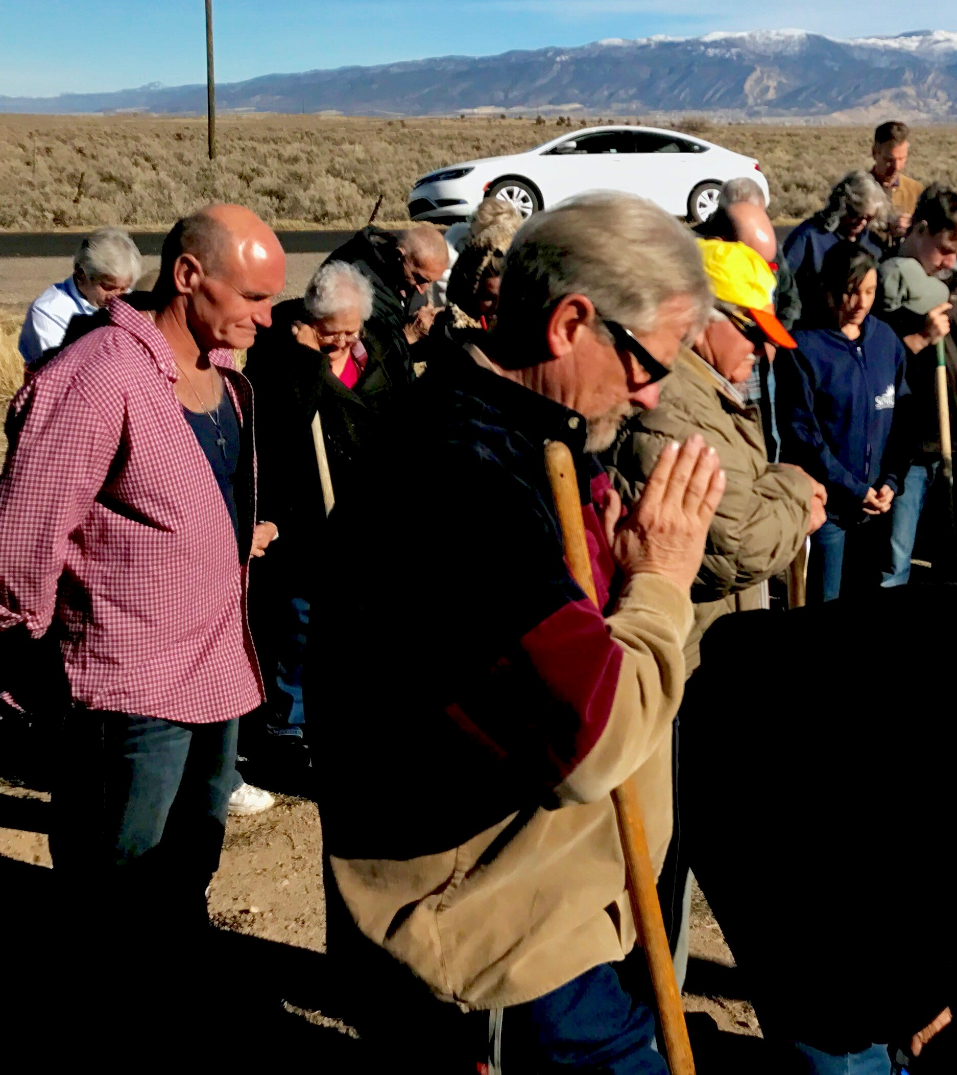 Church members pray as Pastor Jim Vasquez dedicates the property where the new Sonrise Fellowship Church will be built. Iron County, Utah, Dec. 4, 2016 | Photo by Tracie Sullivan, St. George News / Cedar City News
