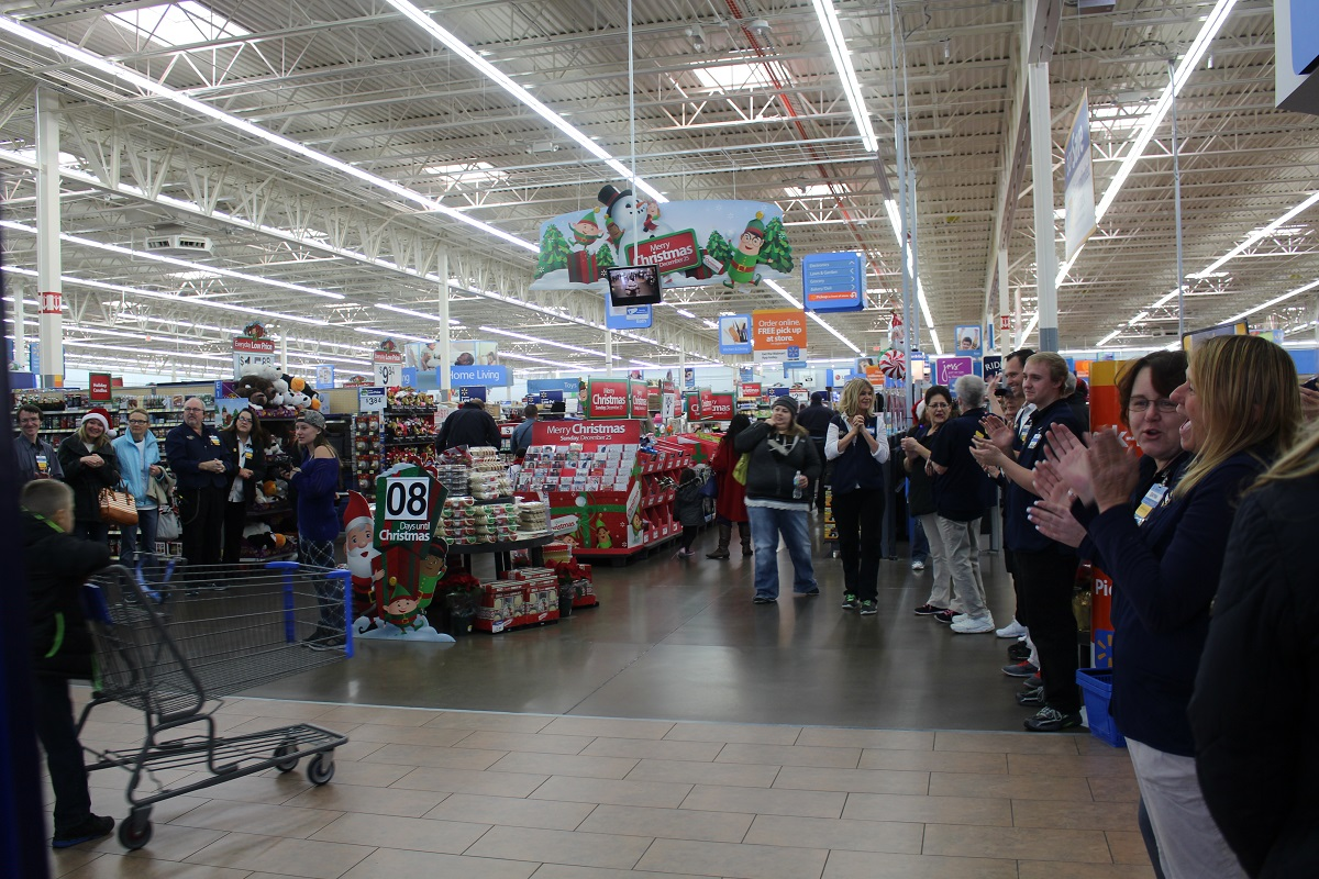 Wal-Mart employees gave a standing ovation as officers and children entered the store Saturday morning for Shop with a Cop, Bloomington Wal-Mart, St. George, Utah, Dec. 17, 2016 | Photo by Cody Blowers, St. George News