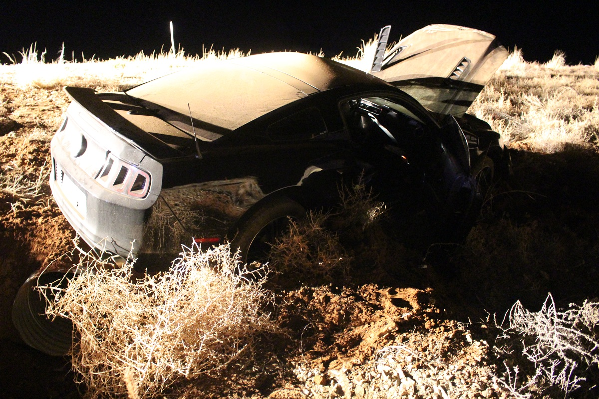Black Ford Mustang after it was struck head-on by a Jeep Compass on SR-59 Wedesday evening, the driver was transported to the hospital with a head injury, Washington County, Utah, Dec. 21, 2016 | Photo by Cody Blowers, St. George News