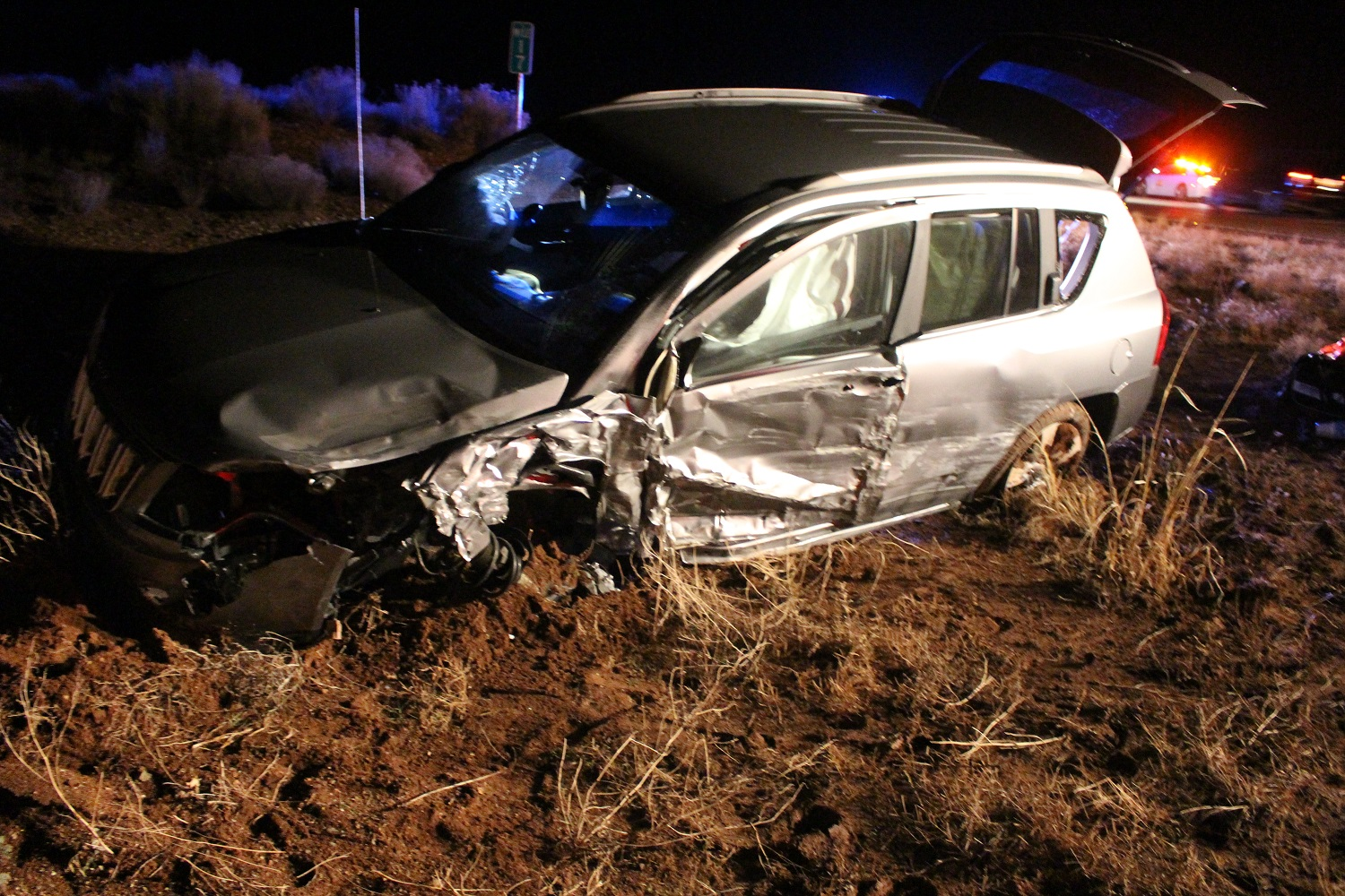 Driver's side view of the Gray Jeep Compass that was found 10-feet from the roadway after a head-on collision on SR-59 sent one driver to the hospital Wednesday evening, Washington County, Utah, Dec. 21, 2016 | Photo by Cody Blowers, St. George News