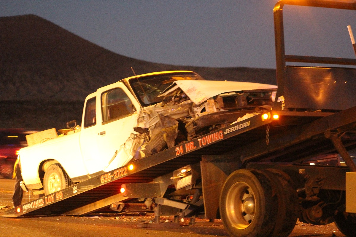 White Mazda pickup truck on tow truck after three-car collision at 3400 West and SR-9 Saturday in Hurricane, Utah, Dec. 3, 2017, | Photo by Cody Blowers, St. George News