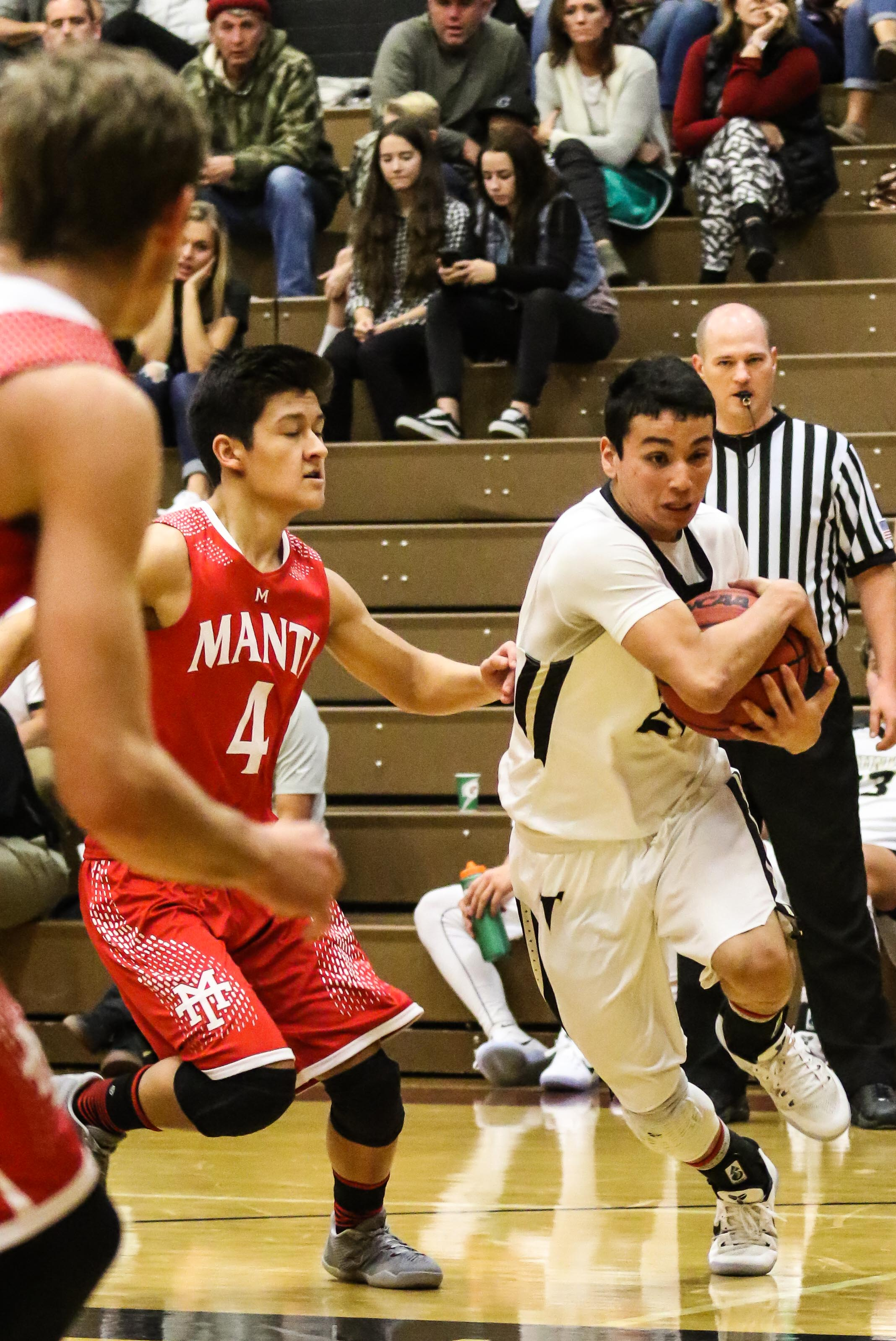 Desert Hills' Isaac Olivas (21), Desert Hills vs Manti, Coach Walker Classic, Boys Basketball, St. George, Utah, Dec. 17, 2016, | Photo by Kevin Luthy, St. George News