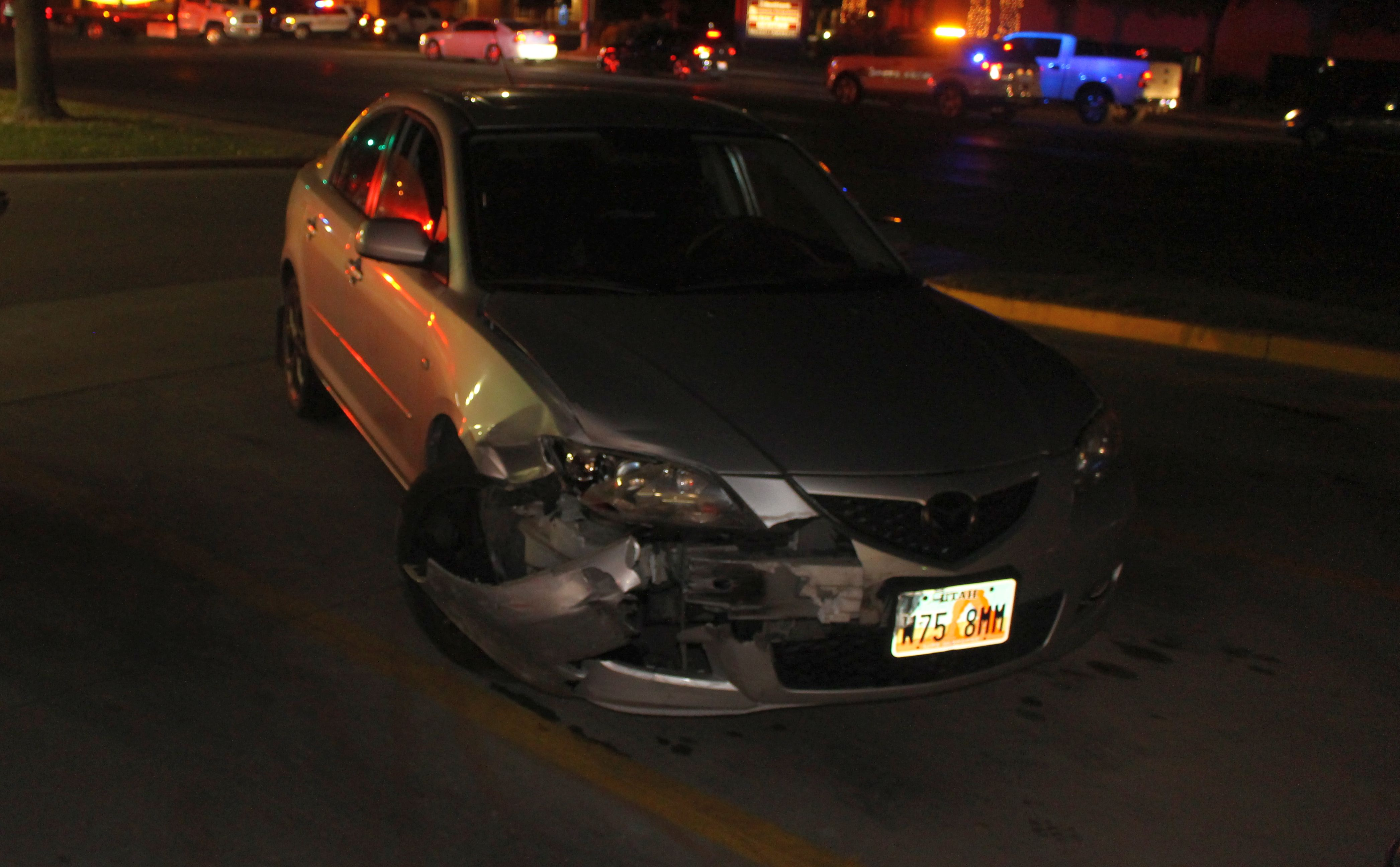 A Mazda site in the parking lot of Maverik after a collision Monday night at 700 South and River Road. St. George, Utah, Dec. 5, 2016 | Photo by Ric Wayman, St. George News