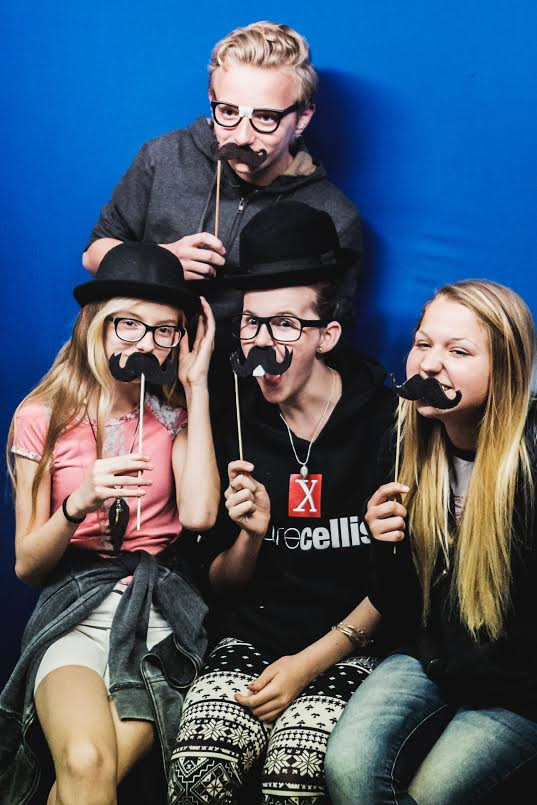 A group of friends pose with mustaches during a previous Georgefest event, St. George, Utah, date not specified | Photo courtesy of Emceesquare Media Inc., St. George News