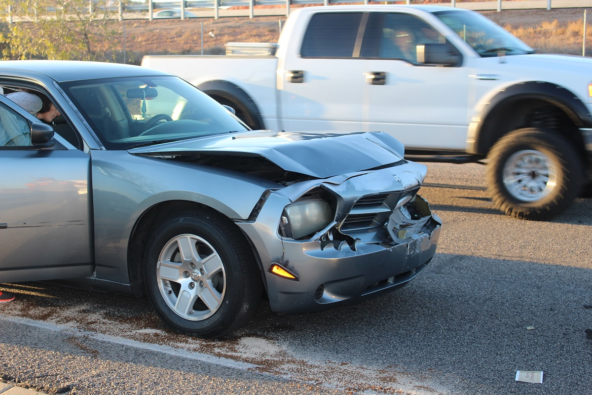 Charcoal gray Chrysler Charger sustains front and rear damage after three-car crash on Red Cliff Drive Saturday afternoon, St. George, Utah, Dec. 17, 2016| Photo by Cody Blowers, St. George News