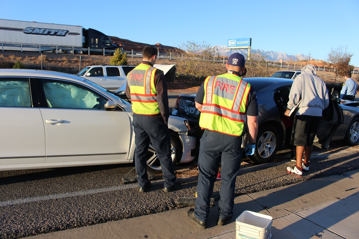 Emergency responders attempt to pull the Volkswagen and Charger apart after three-car crash on Red Cliff Drive Saturday afternoon, St. George, Utah, Dec. 17, 2016| Photo by Cody Blowers, St. George News