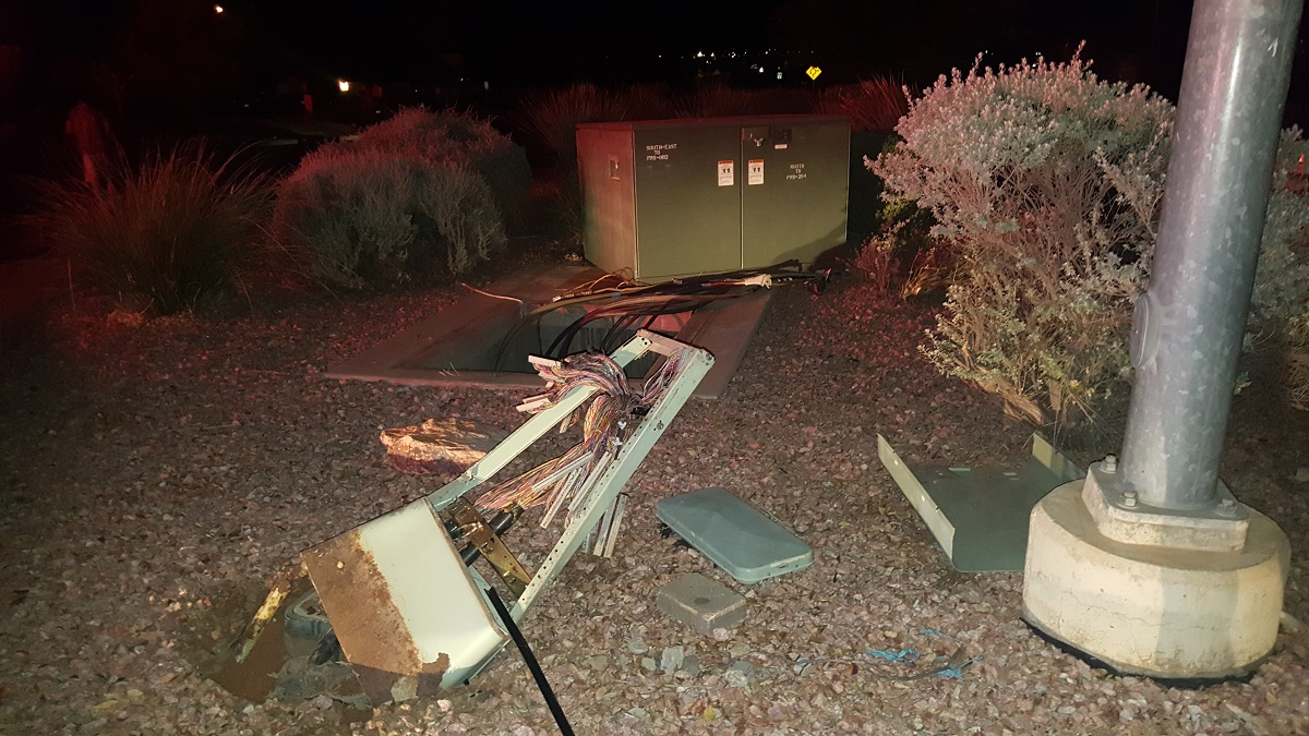 A transformer box is severely damaged when it is struck during a two-vehicle collision that officers said was caused when a woman ran a stop sign Wednesday evening in St. George, Utah, Dec. 7, 2016 | Photo courtesy of Cody Pitcher, St. George News