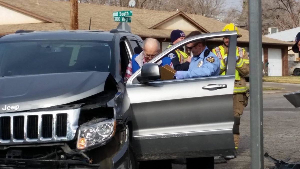officers and firefighters check on the elderly man driving the Jeep after two car crash on W. 100 South and S. 300 West Friday morning that involved two vehicles that resulted in no serious injuries, St. George, Utah, Dec. 23, 2016 | Photo by Brett Barrett, St. George News