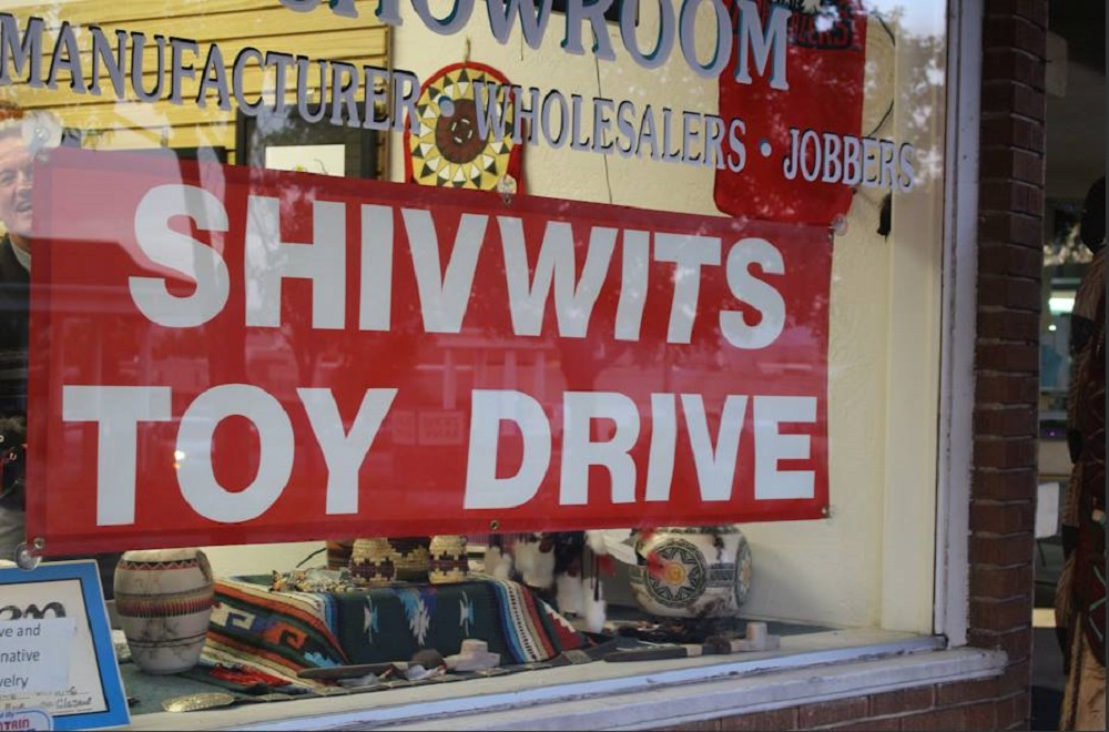 Shivwits Toy Drive banner hangs in the window of M & S Turquoise, located at 53 E. St. George Blvd., St George, Utah, Nov. 23, 2016 | Photo by Cody Blowers, St. George News
