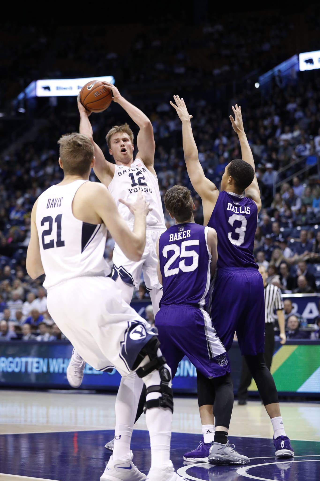 Eric Mika (12) looks to pass to Kyle Davis, BYU vs. Weber State, Provo, Utah, Dec. 7, 2016 | Photo by BYU Photo