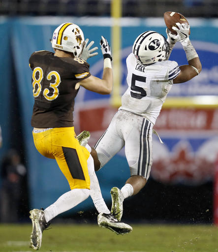 BYU defensive back Dayan Lake, right, intercepts the football in front of Wyoming wide receiver Jake Maulhardt, left, on a pass by quarterback Josh Allen during the second half of the Poinsettia Bowl NCAA college football game Wednesday, Dec. 21, 2016, in San Diego. (AP Photo/Ryan Kang)