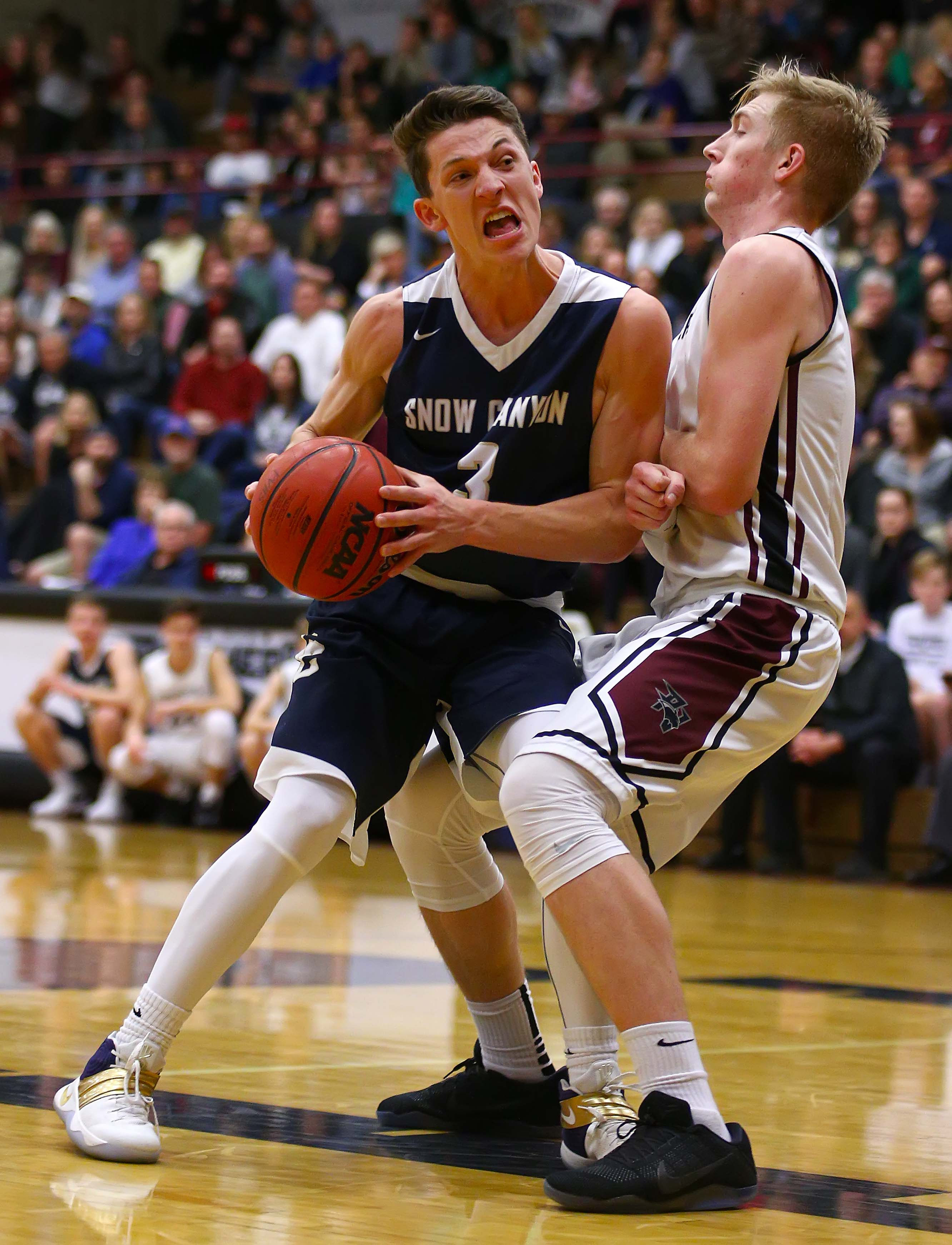 Snow Canyon's Braden Baker (3) and Pine View's Trey Farrer (5), Pine View vs. Snow Canyon, Boys Basketball, St. George, Utah, Jan. 11, 2017, | Photo by Robert Hoppie, ASPpix.com, St. George News