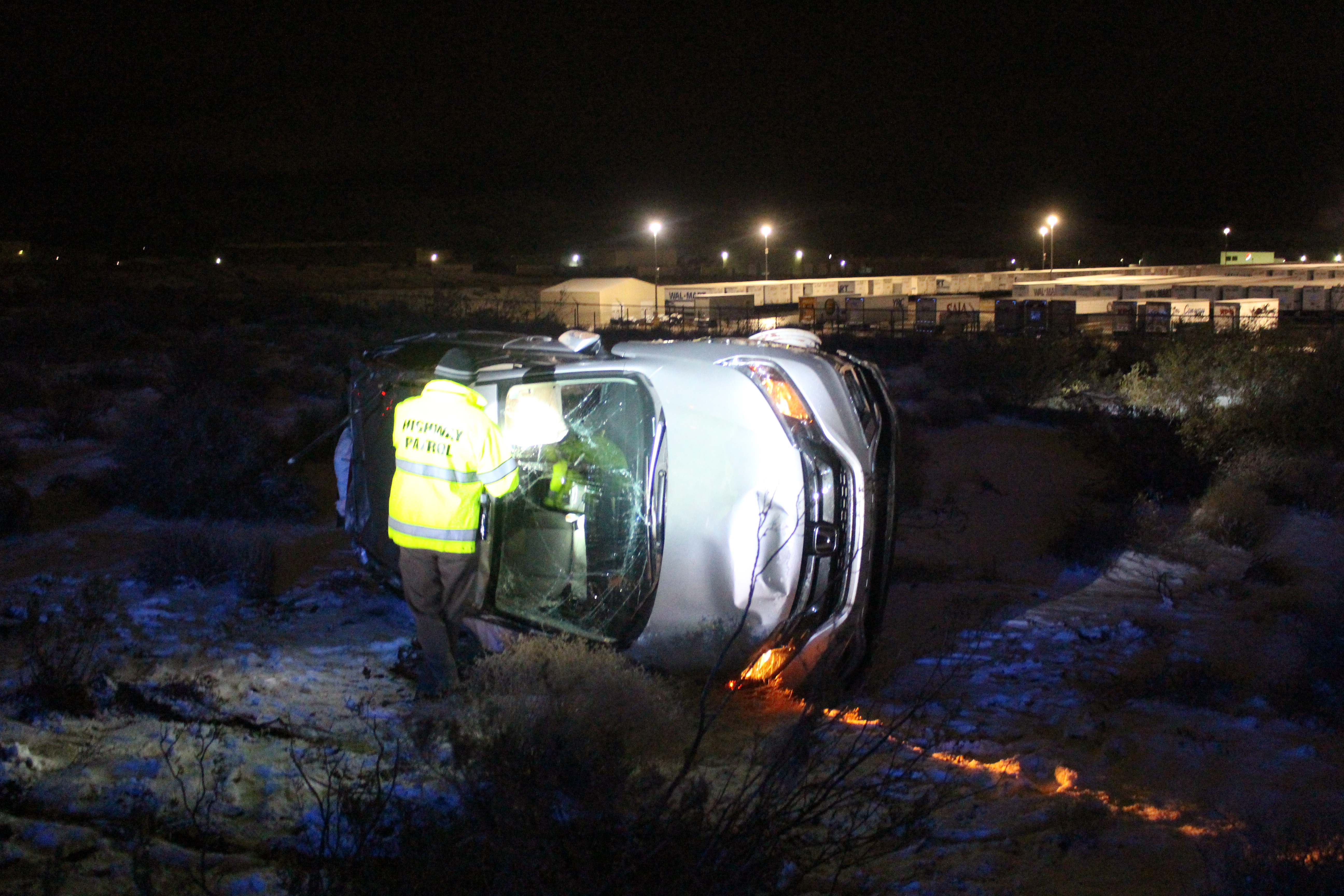 A Utah Hightway Patrol trooper examines a Honda CRV after it rolled in icy conditions on Interstate 15, Washington County, Utah, Jan. 5, 2017 | Photo by Joseph Witham, St. George News