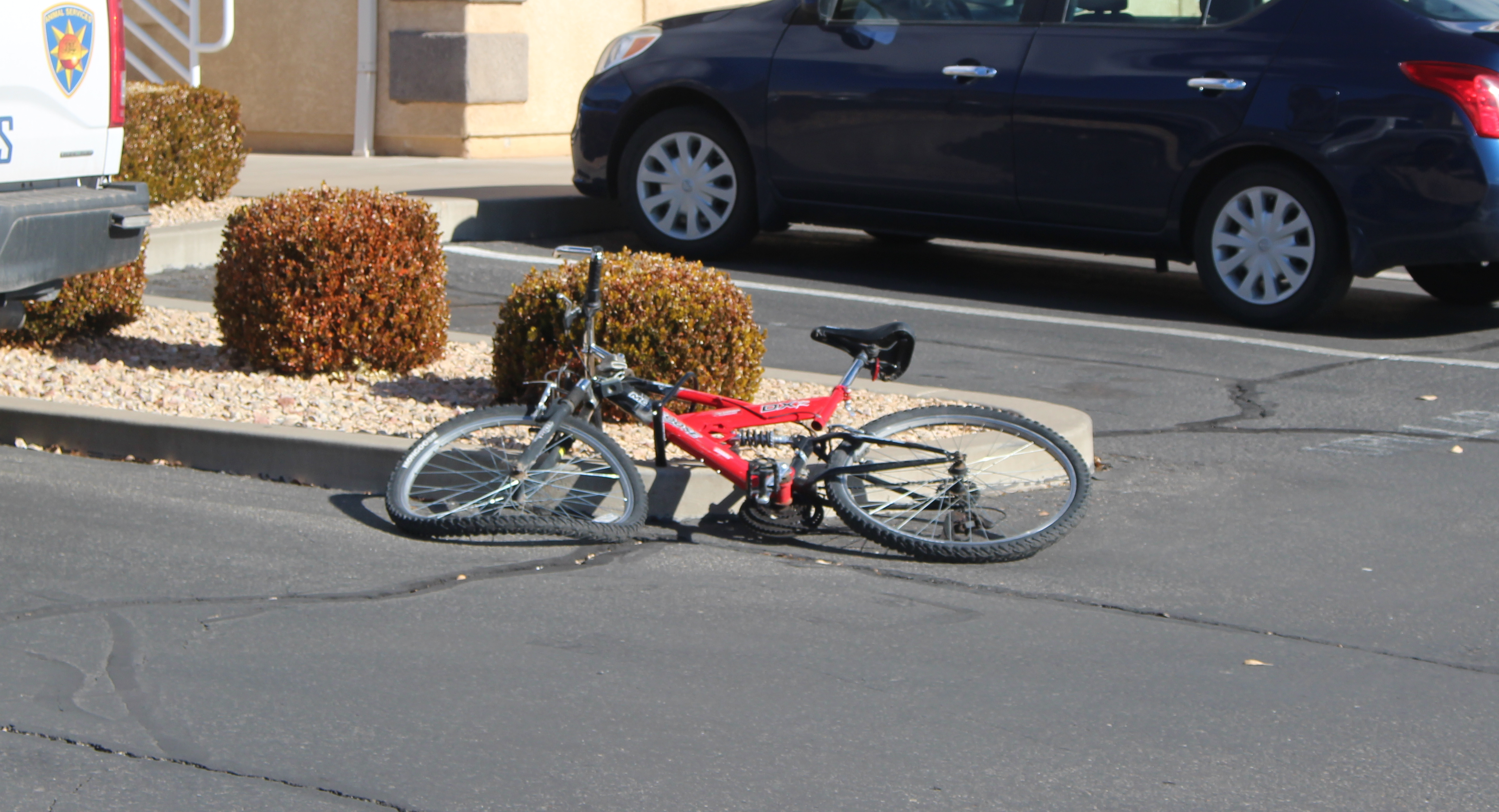 A bicycle sits in the parking lot with its wheel damaged after a collision Wednesday on 100 South. St. George, Utah, Jan. 11, 2017 | Photo by Ric Wayman, St. George News