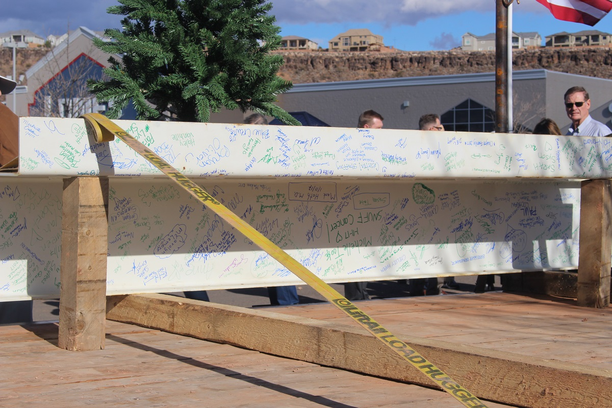 White steel beam with hundreds of signatures is hoisted to the top of the steel structure during a 'topping out' ceremony held Wednesday at Dixie Regional Medical Center's River Road Campus in St George, Utah, Jan. 11, 2017 | Photo by Cody Blowers, St. George News