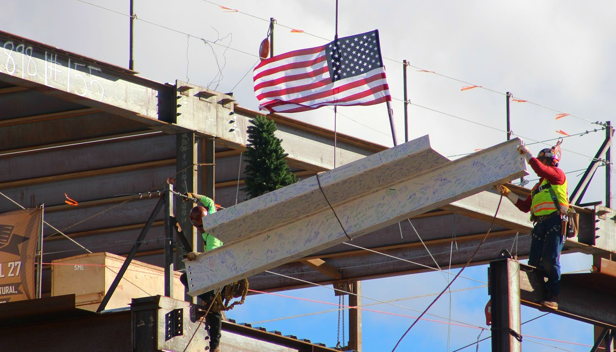 Iron workers securing final steel beam during the 'topping out' ceremony at Dixie Regional Medical Center's River Road Campus in St George, Utah, Jan. 11, 2017 | Photo by Cody Blowers, St. George News