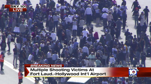 In this still image from video provided by NBC TV Local10, people stand on the tarmac after shots were fired at the international airport in Fort Lauderdale, Fla., Friday, Jan. 6, 2017. Local10 and other news media outlets reported Friday that multiple people were shot | Photo courtesy of NBC TV Local10 via The Associated Press, St. George News