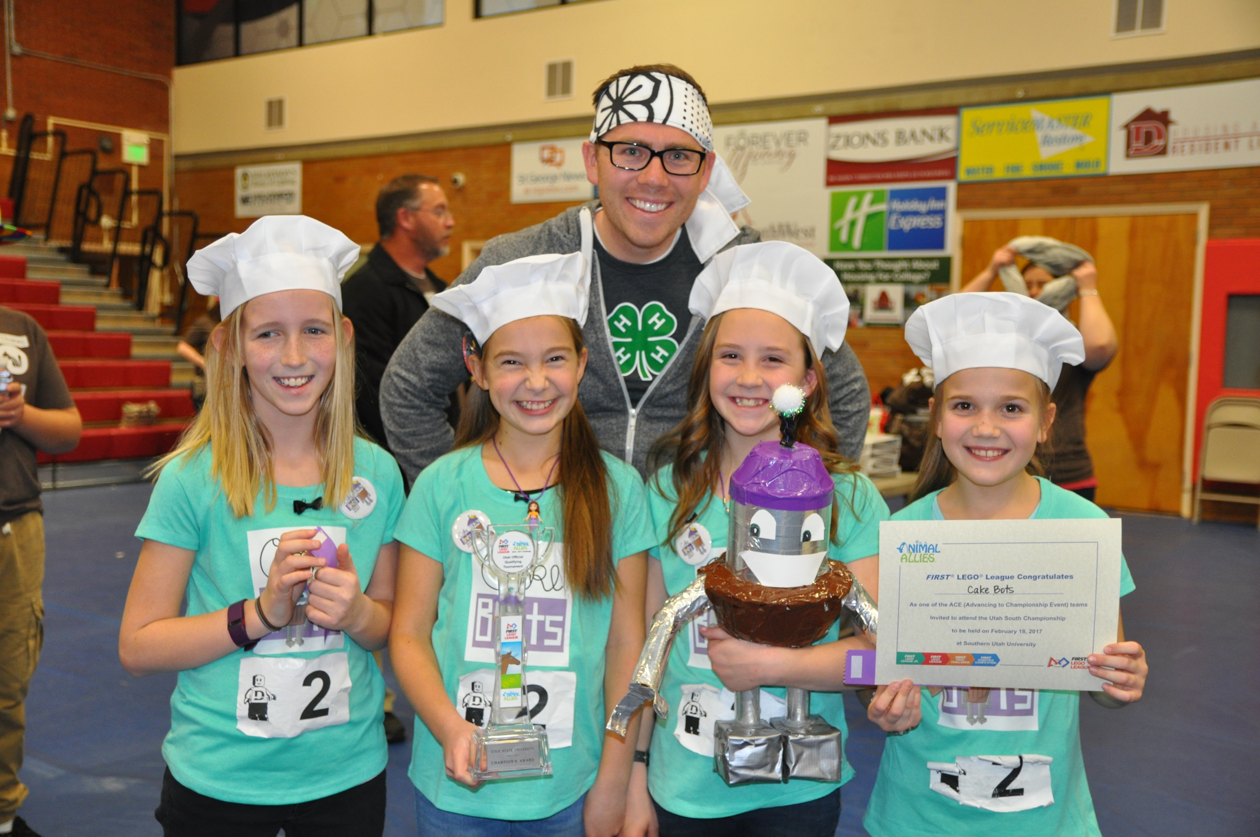 Emma Horn, Adri Baker, Kate Jones and Brinley Wilstead of the 4-H Cake Bots display their Champion's Award trophy at the First Lego League competition, Dixie State University, St. George, Utah, Jan. 7, 2017 | Photo by and courtesy of Sterling Jones, St. George News