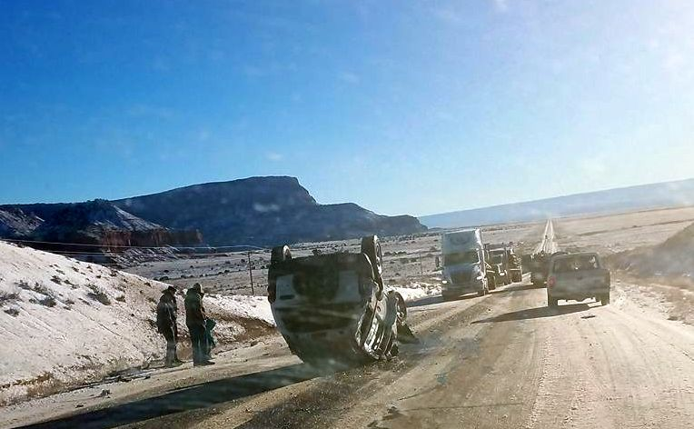 A Jeep sits in the middle of  Arizona state Route 389 Friday after rolling over. Occupants at the side of the road are waiting for authorities to arrive. Colorado City, Arizona, Jan. 6, 2016 | Photo courtesy of Michael DeMille, St. George News
