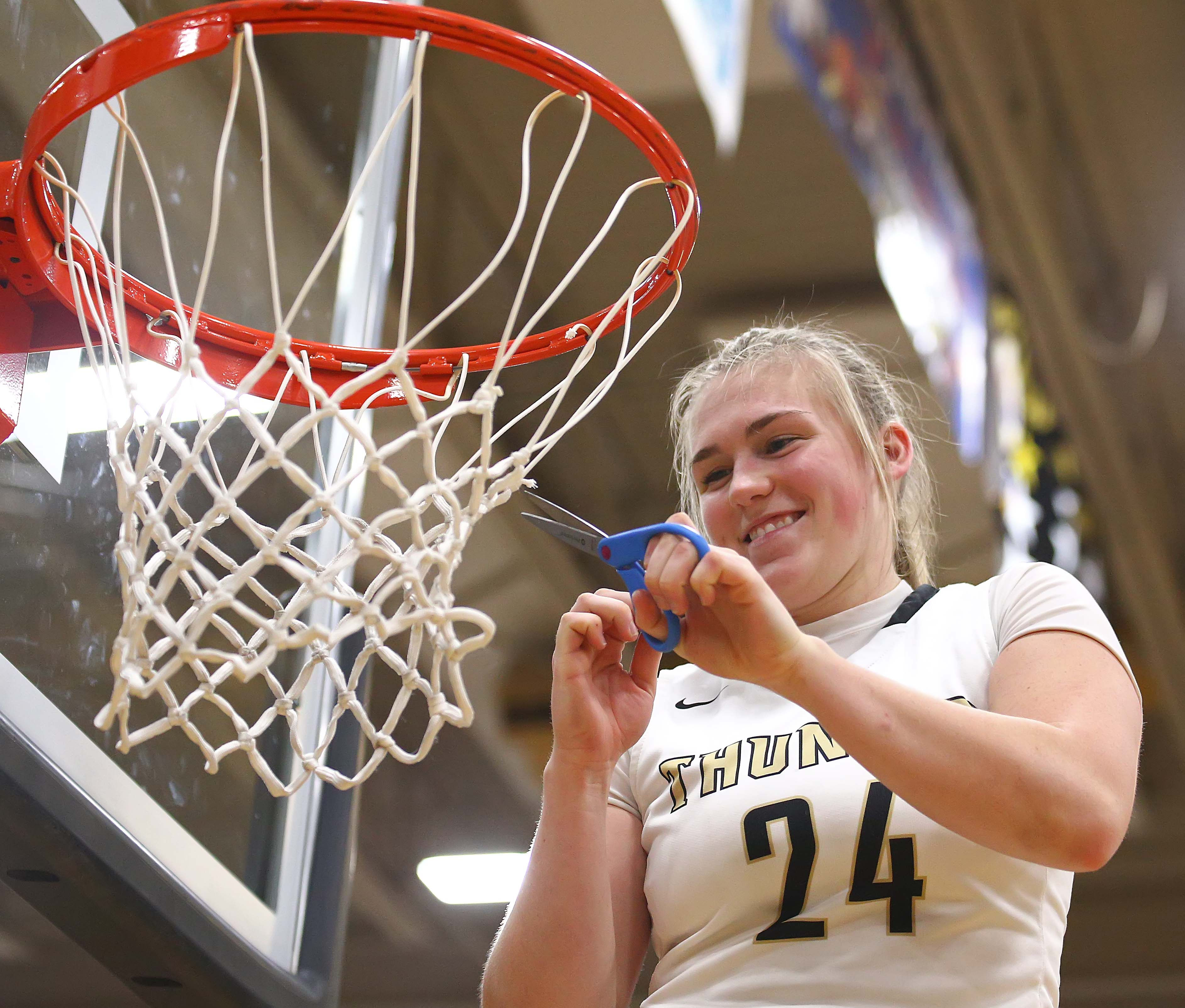 Desert Hills\u0027 Ashley Beckstrand (24) cuts down the net after her team  clinched the Region 9 championship, Desert Hills vs. Snow Canyon, Girls  Basketball,