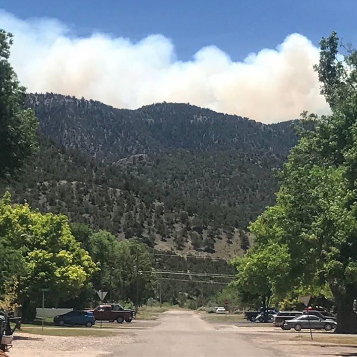 Crews continue to fight wildfire that forced town evacuation