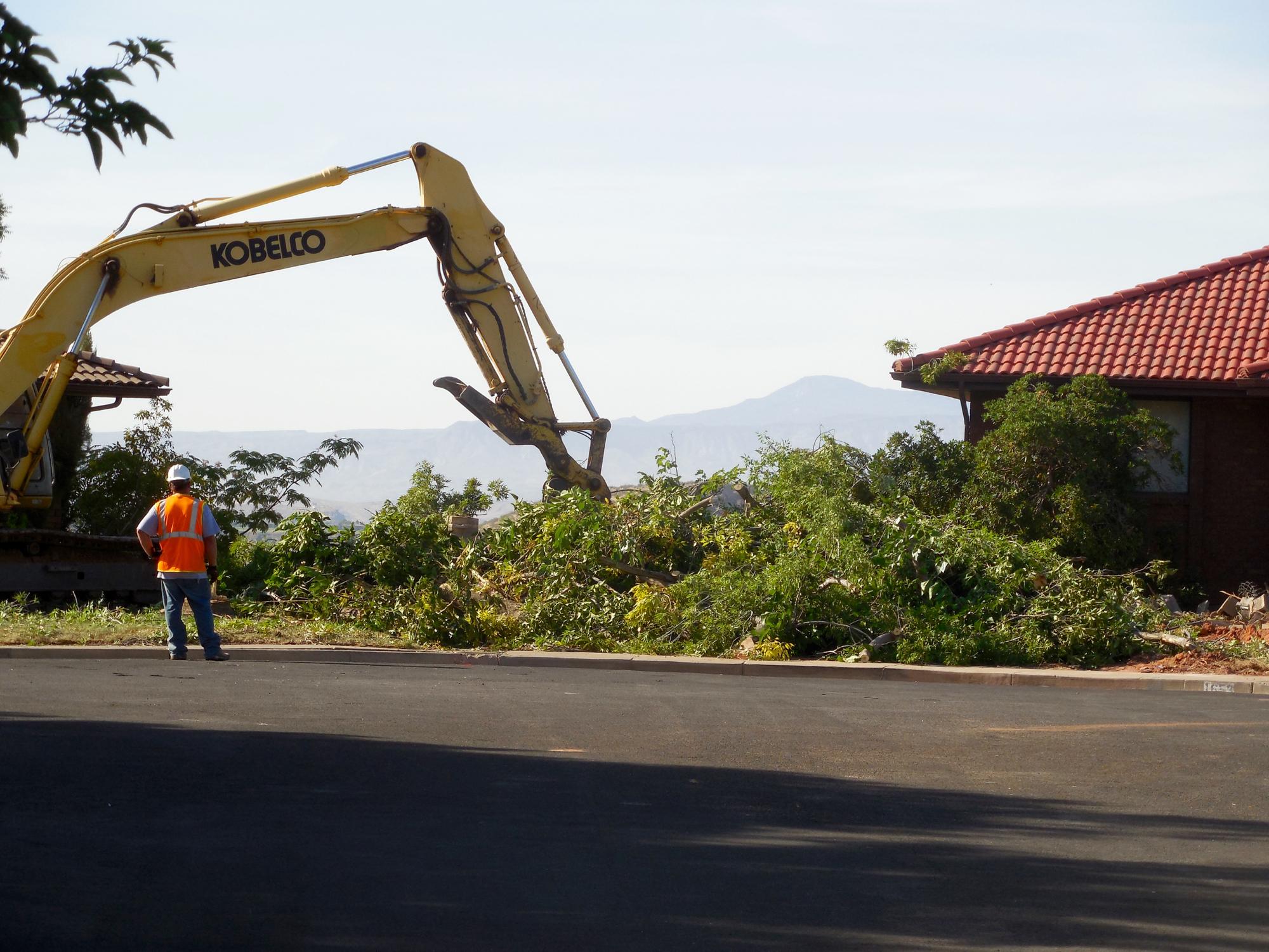 city tears down homes in slide area work on hillside set to begin
