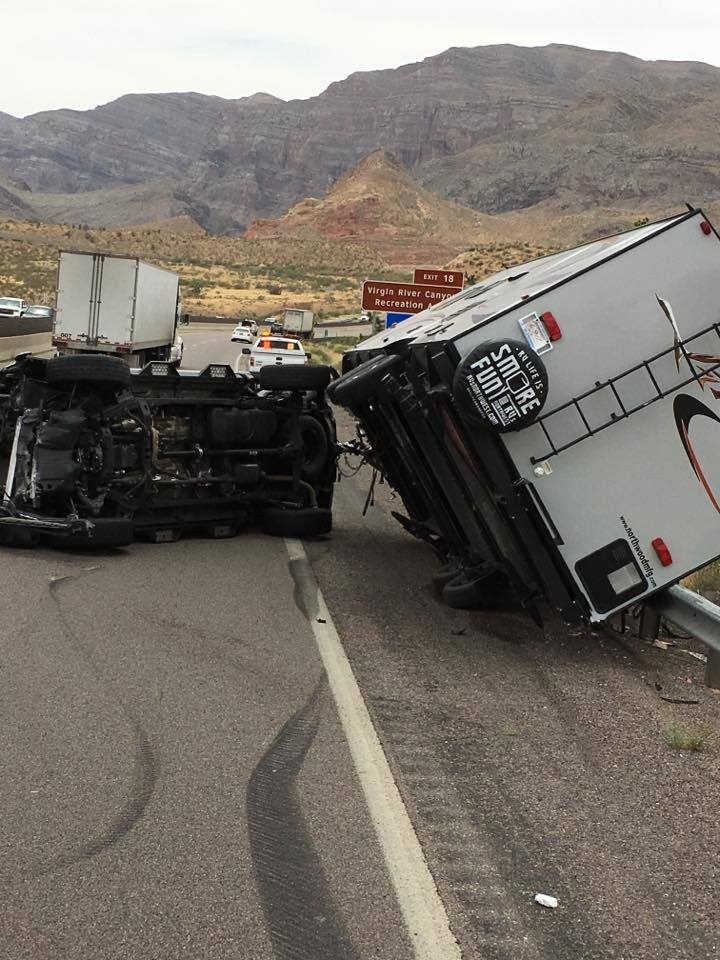 Driver blames wind gust after truck, new trailer jackknife