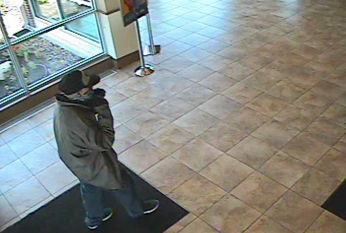 Police release photos of man sought in Jacksonville bank robbery