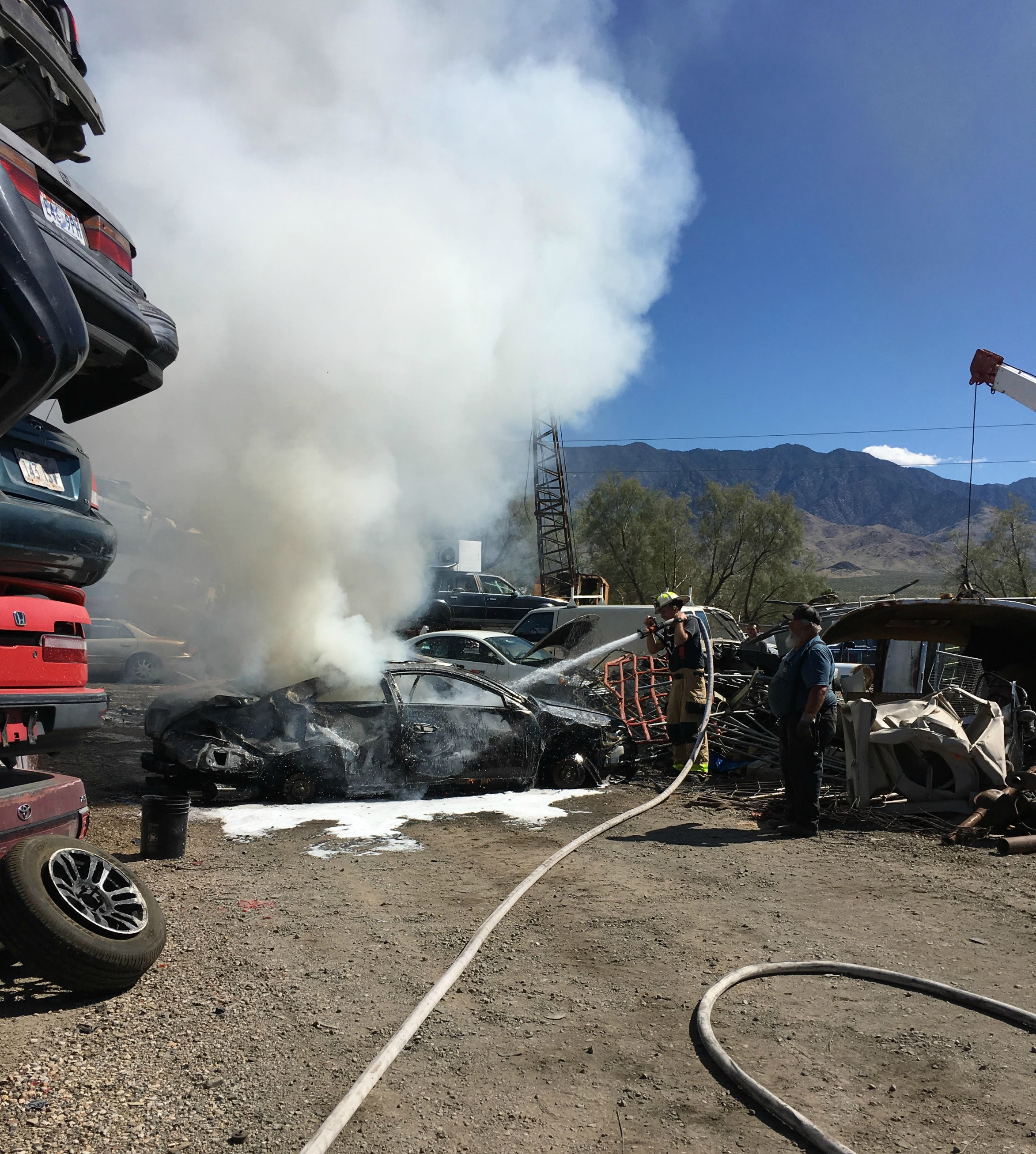Man injured when car catches fire in salvage yard – St George News