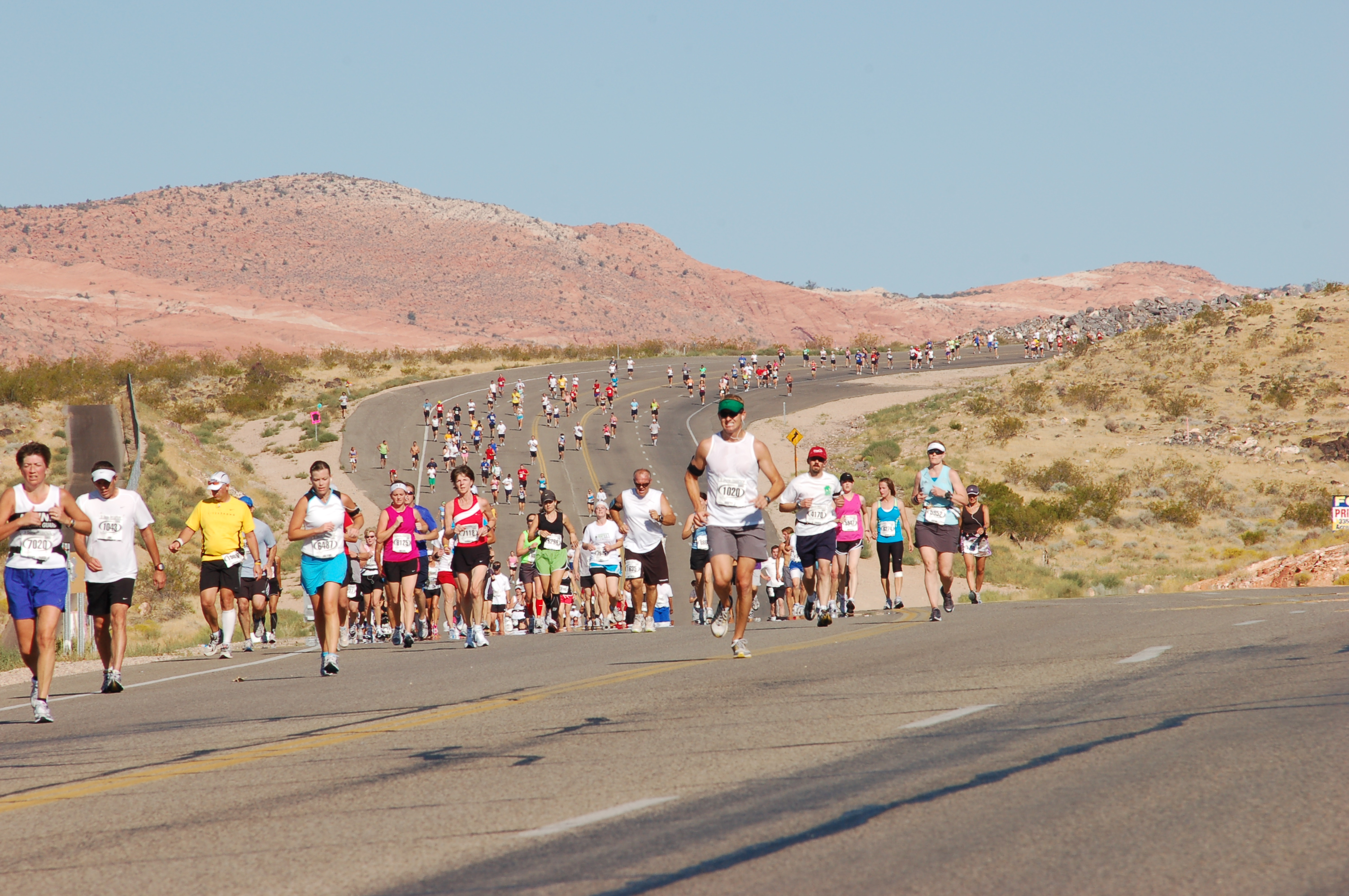 A Pack Of Runners Lines The Course Midway Through The 2010 St. George  Marathon. | Photo By Michael Rinker, St. George News