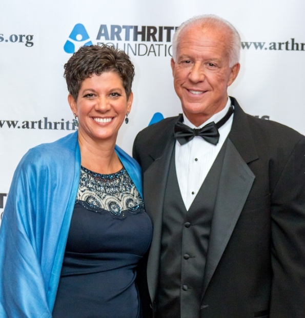 this undated photo shows from r l dr jeff mathews with his wife amy mathews at an arthritis foundation event mathews has practiced medicine in utah for