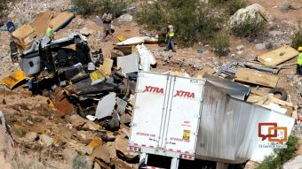 Driver killed when semi launches off I-15 into bottom of
