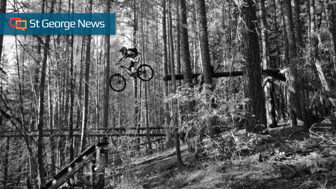 """b4609b799ea Kaylee Gibb makes a jump in a wooded area of Canada, date not specified    Photo courtesy of Ryan Gibb, St. George News. """""""