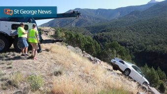 Driver bounces over boulder field off I-15 but averts 7