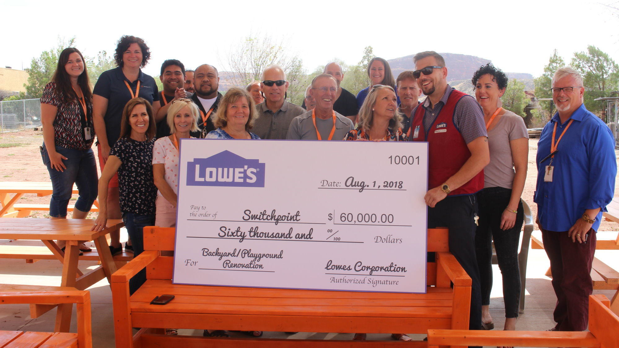 Lowes Donates 60k To Switchpoint For Playground St George News 4 Way Switch Staff Of The Community Resource Center And Ben Kohler Store Manager Home Improvement In Stand Next An Oversized Check