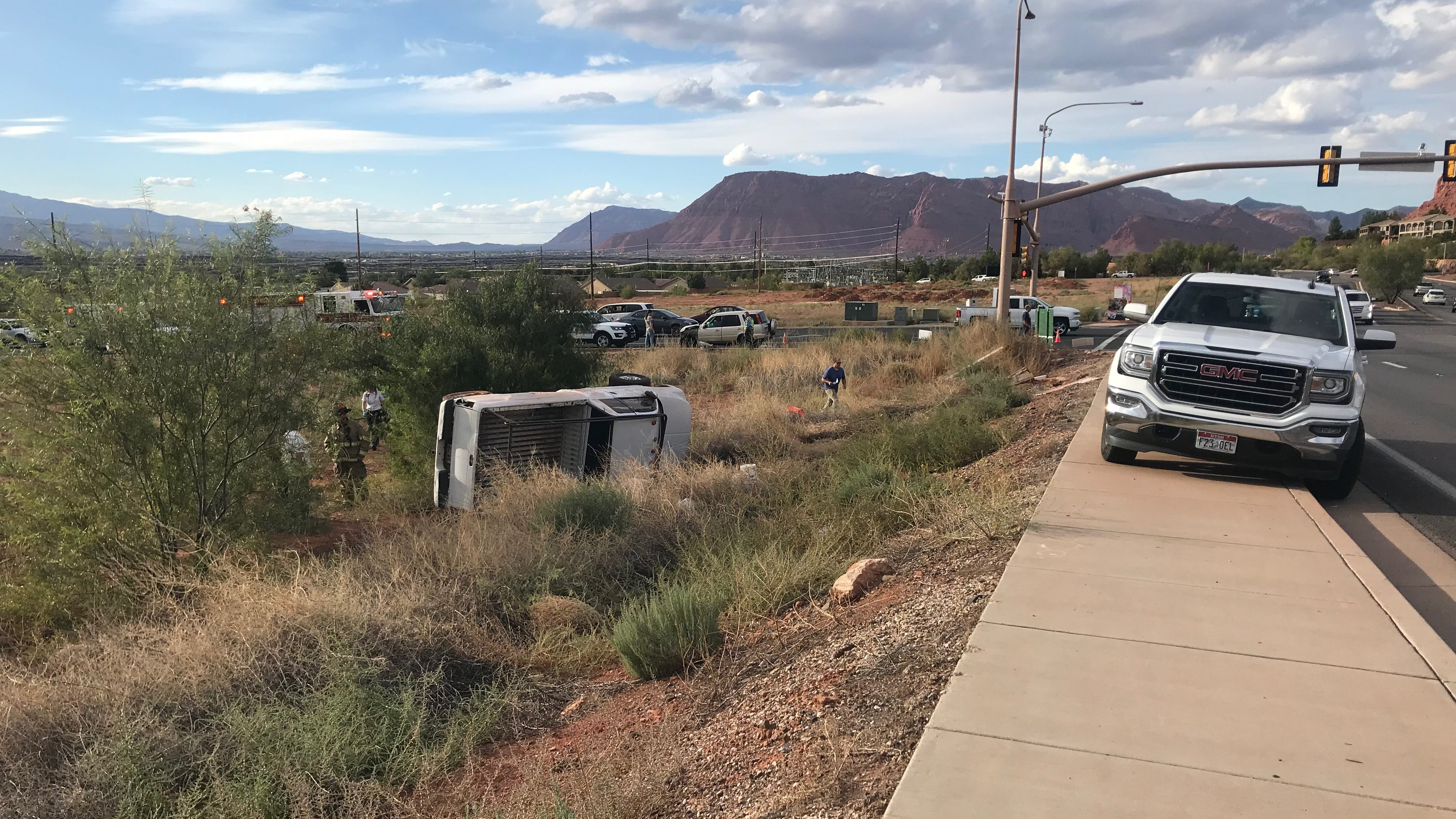Bystanders help pull man from overturned pickup truck after crash ...