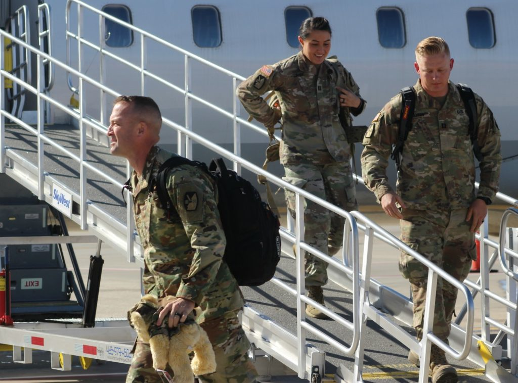 Water cannon salute at airport welcomes Utah National Guard